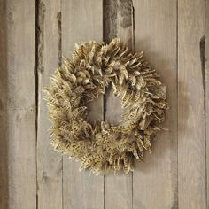 Plumage Wreath | This feather-adorned wreath is both delicate and striking. Its downy texture adds an eye-catching layer of lightness to your interior décor.