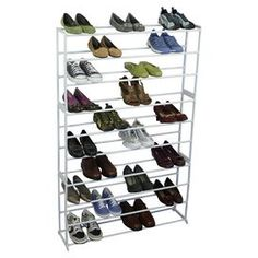 """White shoe storage rack. Holds fifty pairs of shoes.  Product: Shoe rackConstruction Material: MetalColor: WhiteFeatures: Holds fifty pairs of shoesDimensions: 54.96"""" H x 35.5"""" W x 8.86"""" D"""