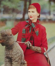 A vibrant, lovely deep strawberry red ensemble from 1957, complete with a cute poodle.