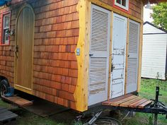 the front of Abel's vardo - doors are(left to right): Composting toilet, washer and clothes hanging space, and the utility closet (which is sealed from the rest of the vardo). Utilities = contains propane, battery (for trailer brakes), electrical panel, hot water heater, and a bunch of water plumbing.