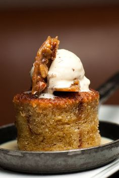 French Toast Bread Pudding with Bourbon-Maple Syrup and Butter-Pecan Ice Cream.