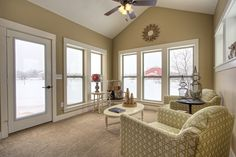This room would be a great way to enjoy the scenery during Michigan winters. When summer rolls around you can open all windows to create an all seasons porch feel. #AllenEdwin #NewHomesLiveBetter #Entertaining #HostessWithTheMostess #InteriorDesign #BeigeIsNotBoring #PatternedChairs #Dumont #GAllen