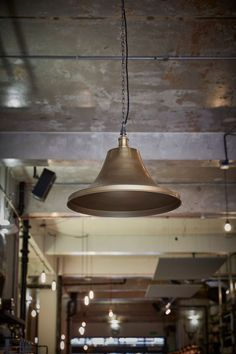 Our Giant Bell in Brass: https://www.industville.co.uk/collections/ceiling-lights-lampshades/products/vintage-brooklyn-giant-bell-brass-copper-light