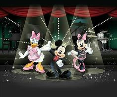 Mickey, Minnie & Daisy putting on a superb stage show.
