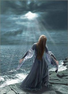 Woman praising the Lord with her heart to heaven at the edge of the sea. Prophetic art painting.