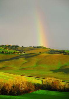 Rainbow field in Tuscany, Italy