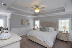 Traditional Master Bedroom with Wainscoting, Demarlos Arched Top Panel Bed, Crown molding, Carpet, Ceiling fan