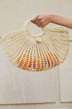 half-moon shaped straw basket