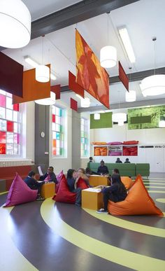 Colorful, portable soft seating and playful directions on the far wall? What a cool, adaptable space.