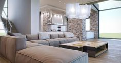 contemporary living room with soft neutral palette, large modular sofa and textured stone wall