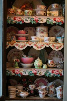 sweet! looks like wallpaper border was used as shelf edging