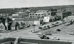 The south side of 49 Street, c. 1950. Now the site of the Millennium Centre. Church on the corner is the old Knox Presbyterian Church built in 1898. The National Supply Company building was originally constructed as Best's Furniture, but served as the Knights of Columbus Hall during the Second World War. In the upper part of the photo, you can see the east side of the Eaton's store.