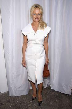 Pamela Anderson Photos Photos - Pamela Anderson attends the Christian Siriano…