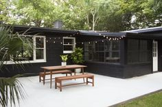 backyard-dining-table-benches-black-painted-brick - Home & DIY Concrete Patios, Poured Concrete, Stained Concrete, Pavillion, Black House Exterior, Paint Your House, Garden Makeover, Backyard Makeover, House Ideas