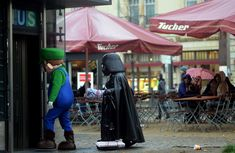 Your destiny lies with me Luigi. (Tourists laugh as street artists enter a subway station at the Brandenburg Gate in Berlin, Germany on October 25, 2012.)