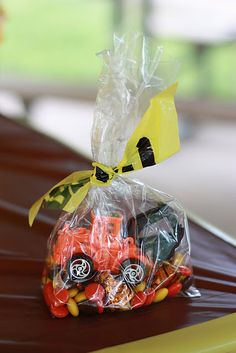 Each treat bag had a little toy tractor, some caramel-filled kisses (as construction cones) and a little pile of Reese's Pieces, which were perfectly colored for the theme. I simply tied them in cellophane bags with…you guessed it…caution tape!