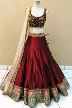 Maroon Colour Banglori Silk Fabric Party Wear Lehenga Choli Comes with matching blouse. This Lehenga Choli Is crafted with Embroidery,Lace Work This Lehenga Choli Comes with Unstitched Blouse Which Ca. Indian Gowns Dresses, Indian Fashion Dresses, Dress Indian Style, Indian Designer Outfits, Lehenga Choli Designs, Lehenga Choli Online, Indian Lehenga, Silk Lehenga, Anarkali Lehenga