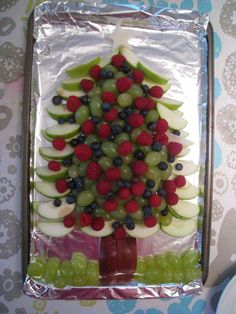 Healthy holiday fruit platter in the shape of a Christmas tree.
