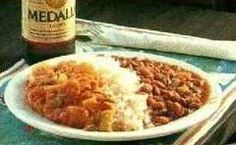 white rice and beans with corn beef and sauce.