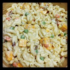 Bacon Cheddar Ranch Pasta Salad!! 3 cups uncooked macaroni, 1 cup frozen peas and carrots, 1 small onion diced, 6-8 strips bacon cooked and diced, 1 - 1-oz. packet Ranch dressing mix, 1-1/2 cups Miracle Whip, 1-1/2 cups mayonnaise, 1 - 8-oz. package block cheddar cheese cubed
