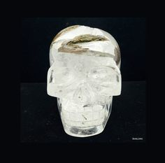 This huge clear quartz skull is made from a rare piece of clear quartz with several large epidote inclusions and chlorite. Some parts on top of the skull are still the unpolished natural termination of the quartz and epidote. A unique master piece carved and designed by Leandro. This piece is available on Etsy!    https://www.etsy.com/listing/289605625/clear-quartz-with-epidote-skull-23-kg-by?ref=shop_home_active_54    #clearquartz #epidote #chlorite #skulls4u #skull #sculpture #crystalskull…