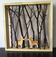 Houten plankjes 54 x 54, takjes en dieren. En in een handomdraai een klein bos art stuk