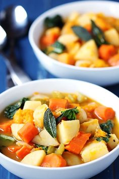 Slow Cooker Root Vegetable Stew flavored with lots of garlic, bay leaves, and sage, and a little chopped kale stirred in at the end.  [#MeatlessMonday #SlowCooker recipe from Gimme Some Oven via Slow Cooker from Scratch]