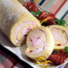 Summery fresh, this low-fat cake roll is filled with strawberry frozen yogurt and frozen. Each slice has fewer than 300 calories! Serve at a shower, graduation, or anniversary party, trimmed with fresh strawberries, orange peel, and mint leaves.