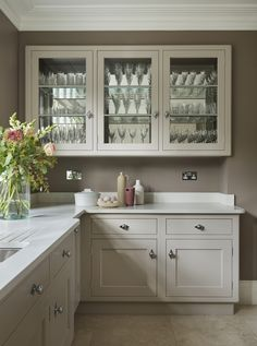 We totally transformed this kitchen, replacing dated, fussy decor with bespoke cabinetry from our Modernist Collection. The result is a  simple, beautiful kitchen on a large scale.