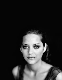 I'm not a huge fan of many actresses, but I do love Marion Cotillard. =)