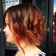 brown curly messy bob with red highlights