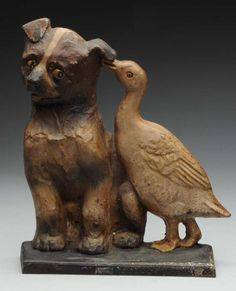 """Signed, """"copyright 1924, A.M. Greenblatt, Boston, Mass., 11"""". Appealing and whimsical piece with duck whispering in Boston terrier pup's ear. Pup has a wonderful expression, well executed casting and paint. Condition (Very Good). Size 10"""" T."""
