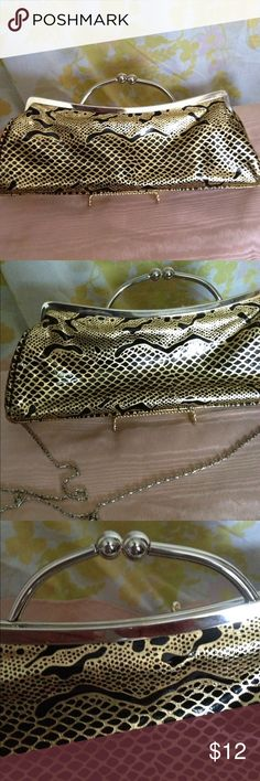"Stunning Black & Gold Clutch by IAN You won't want to save this stunning clutch for evenings only😎👗 Beautiful black and gold pattern highlighted by silver clasp. Shoulder chain can be tucked inside. Length is 13"", height 4 1/2"" bottom is flat at 2"". Black silk like lining. Tight clasp. Excellent like new condition. Worn 1 time. IAN Bags Clutches & Wristlets"