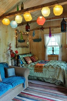 I love the vintage mirror with the twinkle lights.. And the hanging pendants!
