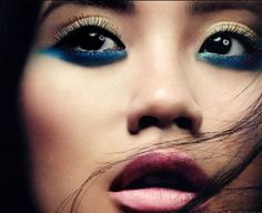 If you get bored of black under-eye liner try some colour :)