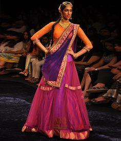 A beautiful pink net ghagra with a fuchsia and gold brocade border. | Neeta Lulla Online Store