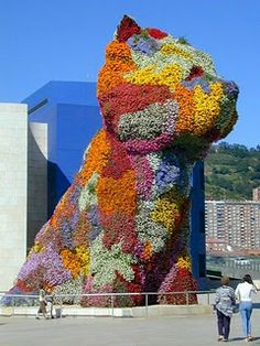 """Jeff Koons """"Puppy"""" is formed by live plants. this colorful West Highland Terrier is outside Bilboa, Spain's Guggenheim Museum"""