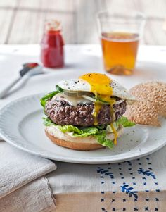 """Susan Spicer Chef-owner of Bayona in New Orleans """"A cheeseburger is something I get a craving for about once a month,"""" Spicer admits. """"After tasting fancy restaurant food all day, there's just nothing better!"""" For a six-ounce """"medium but not dry"""" burger, she grills patties five minutes on the first side, two on the second. Spicer pops a fried egg on top for her husband, Chip. """"It's my version of steak and eggs — and he'll eat one anytime I make it, day or night,"""" she says. INGREDIENTS…"""