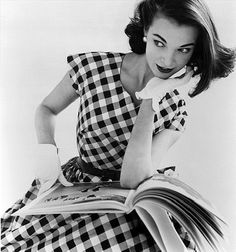 Model: Helen Bunney. Photo: John French. London, 1957 plaid checks black white day dress short sleeves full skirt 50s 60s photo print ad designer vintage fashion