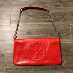 ✨PRICE DROP✨ Tory Burch Reva clutch Used once, Tory Burch shoulder bag. Perfect for going out! Red-orange with gold hardware. Straps are removable and can be used at a clutch. Offer are welcomed also open to trades (bags only) Tory Burch Bags Clutches & Wristlets
