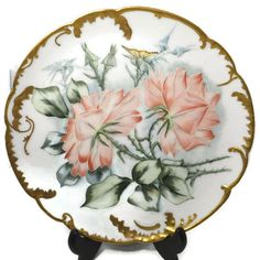 """A beautiful antique Limoges Porcelain China Plate. Decorative scalloped edging with gold trim and pretty pink flowers adorn the plate. Plate measures 8.5"""" diameter and is a lovely example of high quality china from the turn of the century, 1800s-1900s. Marked HaCo, L France. In good vintage condition with no chips, cracks or scratches. A wonderful addition to the French plate or Limoges collection or a beautiful plate for display."""