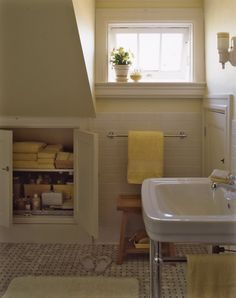 Pale yellow, sunny in a small bathroom