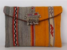 .Ethnic woven bag in the best shades of gray and yellow