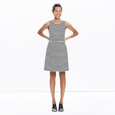 """You loved it, so we brought it back—our sophisticated sleeveless dress returns in timeless stripes. A work-to-whatever favorite, this one erases any what-to-wear worries (and the subtly stretchy fabric means it is so comfy on). <ul><li>Waisted.</li><li>Falls 35"""" from highest point of bodice.</li><li>Viscose/nylon/elastane.</li><li>Machine wash.</li><li>Import.</li></ul>"""