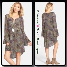 Print Trapeze Dress A swingy silhouette, bell- sleeves and Tassle ties dangling from the neck play up the 70's flavor of a lightweight trapeze dress covered in a swirling floral print.fully lines, 100% rayon. DiamondGirl Boutique Dresses Mini