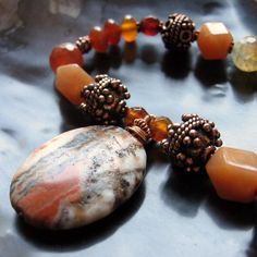 http://www.craftsy.com/project/view/Italian-Onyx-Gemstone-Copper-Necklace/7570 Link to instructions to make this. Love chunky stone necklaces!