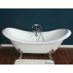 """A very nice closeup of our 71"""" inch cast iron double ended slipper clawfoot tub with Lions paw feet.  Shown with a deck mounted """"British Telelphone"""" faucet with hand-held shower unit.  A fantastic model for lounging, or sharing a romantic evening with a partner."""