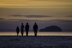 A family leaving the beach at Belhaven Bay as the sun sets over the Bass Rock Sun Sets, Big Kids, Playground, Discovery, Beach, Water, Fun, Outdoor, Children Playground