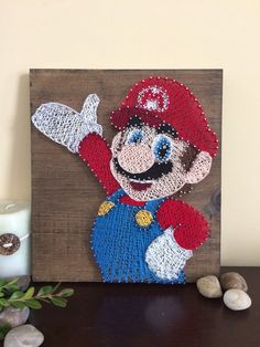 A personal favorite from my Etsy shop https://www.etsy.com/ca/listing/510149543/string-art-super-mario-brothers