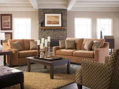 Look to the Ryder with Colfax living room set for smart style and classic comfort. At the heart of this contemporary living room is the lavish Ryder sofa and loveseat. Wrapped in a soft camel microfiber fabric, this set has a low boxy profile with sloping track arms and plump back and seat cushions. Gracing the room is the rich walnut finished Colfax cocktail table with its beveled edge detailing and stylish tapered legs, the ideal backdrop for decorative bowls or a floral display. A ...